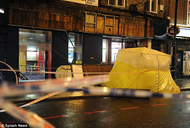 Cordoned off: Police are now carrying out a detailed forensic examination of the scene in Camden Road, north London, for clues about what caused the fatal incident