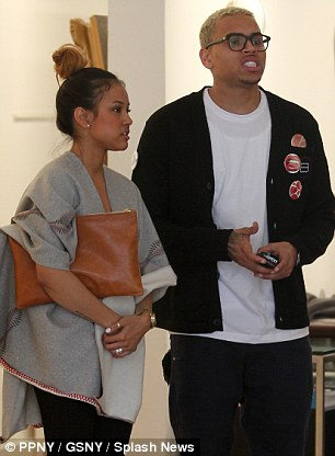 Former love: Tran pictured with ex-boyfriend Chris Brown back in 2011