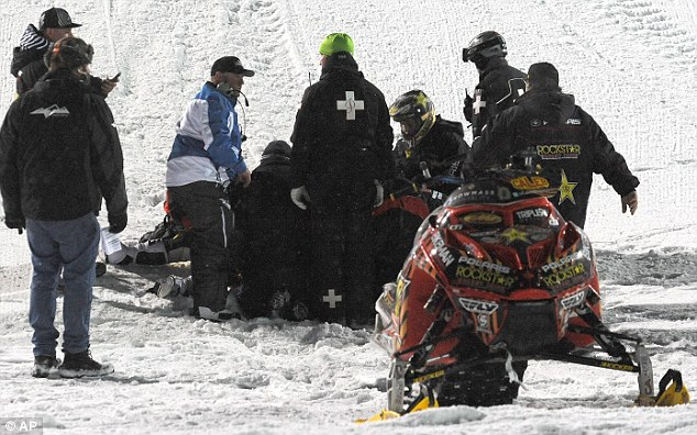First aid: Emergency personnel tend to Moore after his machine landed on top of him last Thursday during the competition