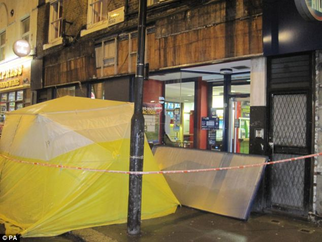 Investigation:The scene outside the Camden Road William Hill betting shop, after a man was killed by a falling sign