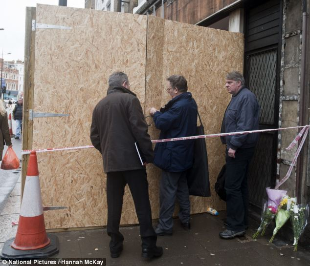 It is feared that the hoarding may have fallen from the front of the building after coming loose in high winds