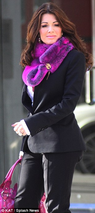 Standing out: Lisa stood out on Monday as she went to her restaurant Villa Blanca wearing a bright purple scarf