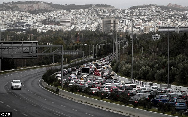 The troubles rage on: Cars are caught in a traffic jam during a strike by metro employees over pay cuts on Thursday