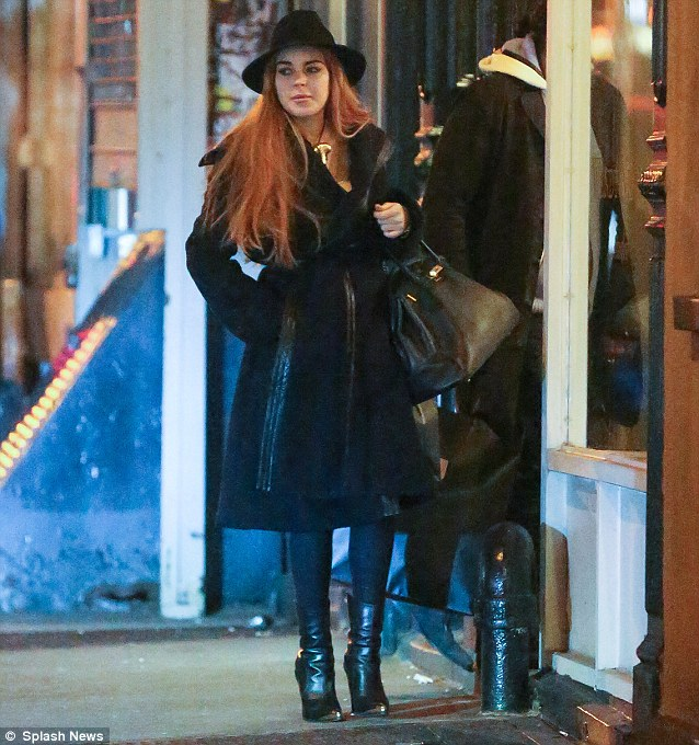 'Too sick to fly'! Lindsay pictured shopping in Soho in New York on Saturday, the same day she allegedly visited a doctor to obtain a sick note