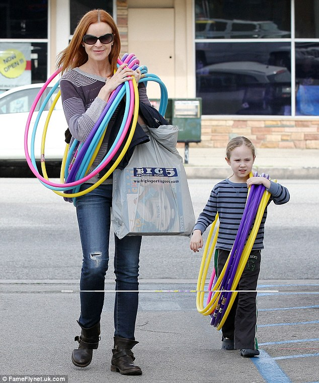 If the hula hoop fits: Marcia Cross and her daughter Savannah had a great time stocking up on fun party supplies at Big 5 on Tuesday and even wore some out of the store