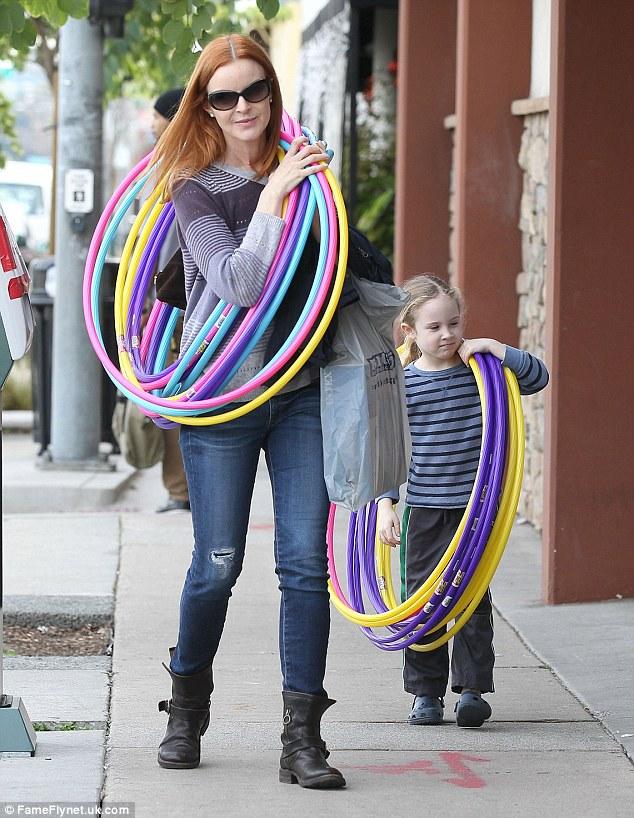 Mama's helper: Savannah tried on some hula hoops for size