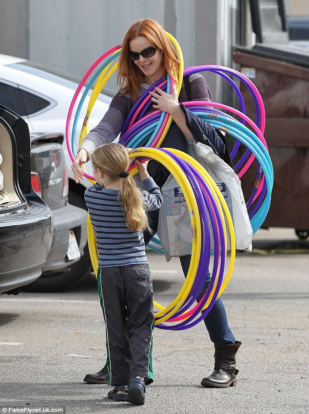 Loading up: Marcia and Savannah had fun getting their hula hoops into the back of their car