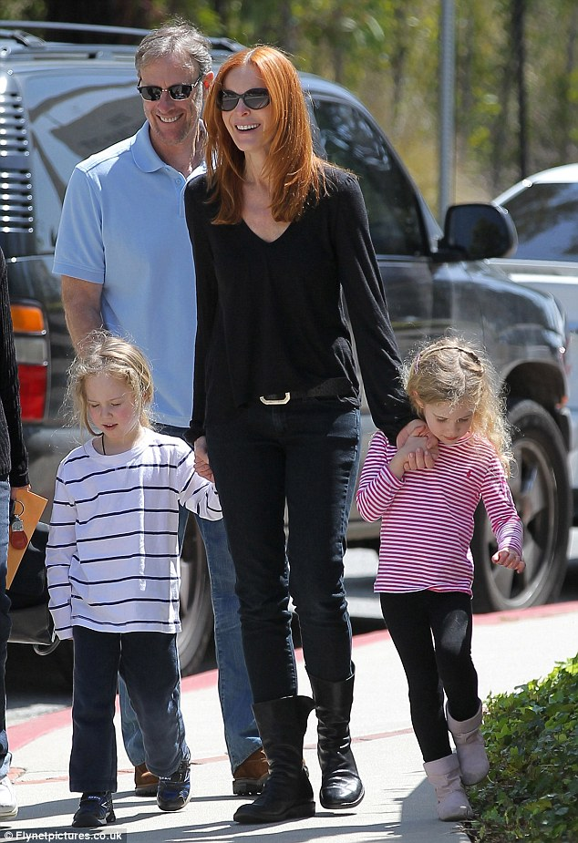 Family fun: Now that she's finished with Desperate Housewives, Marcia has plenty of time to spend with her husband Tom and their girls
