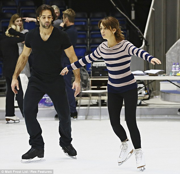 Watchful eye: Samia Ghadie looks nervous as she does some solo skating as partner Sylvain Longchambon looks on