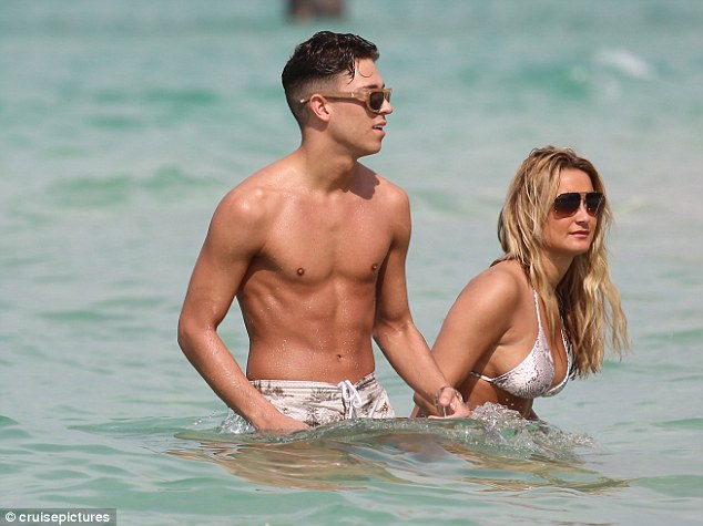 Making the most of it while they can: They both looked tanned and content as they enjoyed their break away from Essex