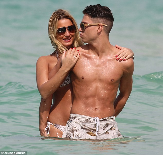 Going in for another kiss? Joey planted yet another smacker on his girlfriend as she took in the sea air