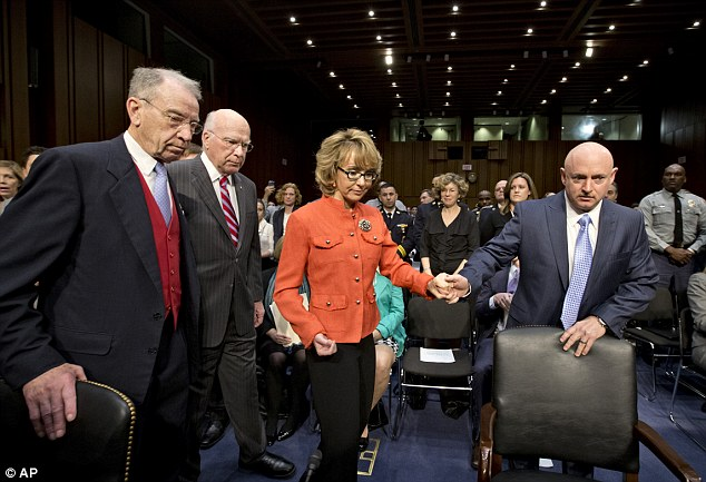 Courageous: Former Arizona Rep. Gabrielle Giffords, who was seriously injured in the mass shooting that killed six people in Tucson two years ago, arrives on Capitol Hill on Wednesday