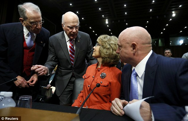 Powerful voice: Giffords is greeted by Committee Chairman Patrick Leahy and Senator Charles Grassley today
