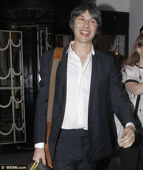 Next in line: Brian looked delighted as he left the Radio Times party on Tuesday evening
