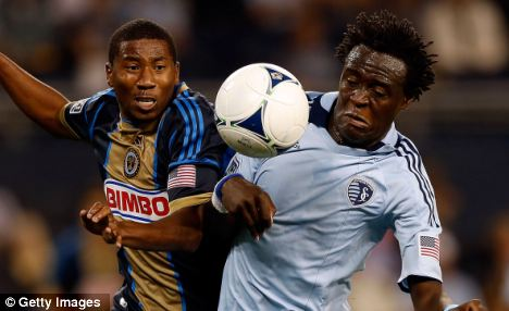 Attacking enforcements: Kia Kamara (right) needs a work permit to seal his move