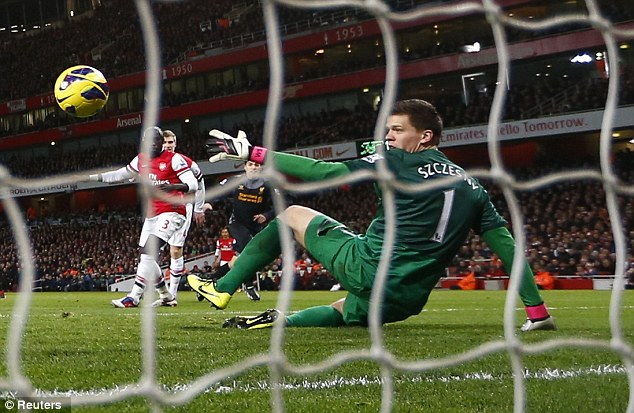 Defensive wobbles: Arsenal had looked to be slipping to defeat after two costly lapses