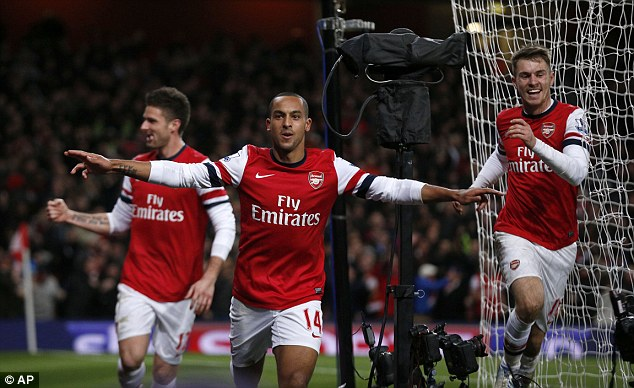 Fightback: Theo Walcott (centre) helped Arsenal come from two goals down to draw with Liverpool