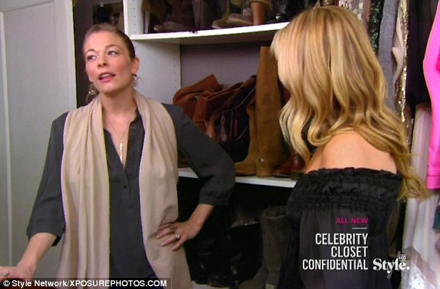 Walk-in wardrobe: LeAnne shows off her extensive array of clothes and shoes, explaining them to the team