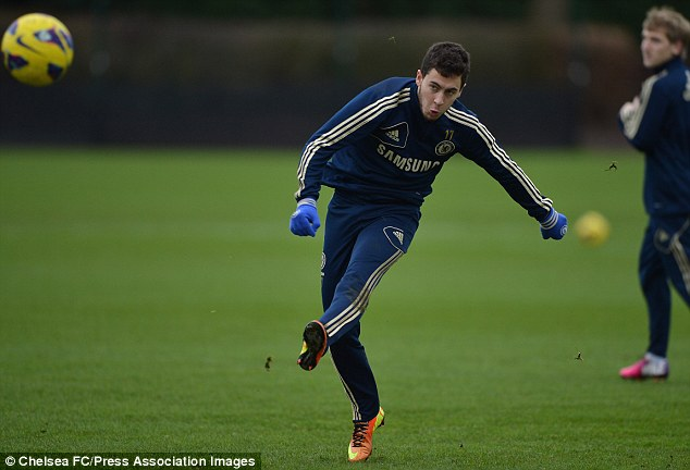Letting fly: Hazard unleashes a firecracker during training at Cobham this week