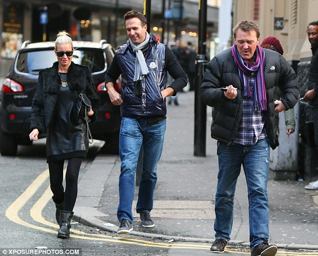 Lads' day out: Ladette Denise joined the boys as they walked around town on their latest city stop