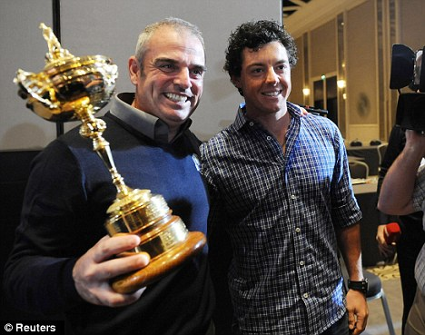 Up for the cup: But Paul McGinley (left) has questioned whether Rory McIlory (right) will play at the Rio Olympics
