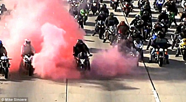Pretty in pink: Biker Hector 'The Tank' Martinez spun his customized wheels, emitting a puff of pink smoke