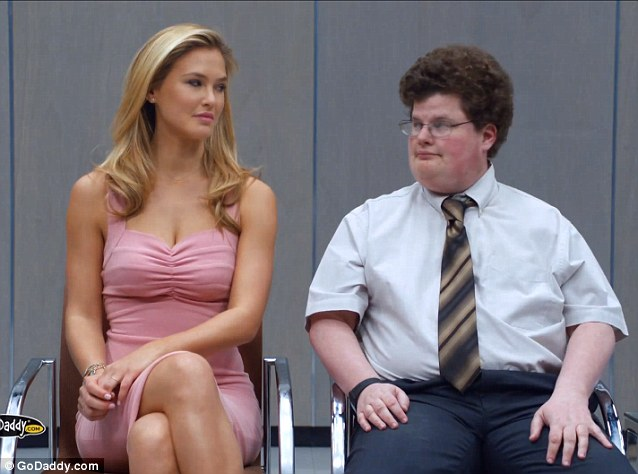 The perfect match? The advert sees Bar introduced by racing star Danica Patrick to longtime Hollywood extra Jesse Heiman, creating what she dubs the 'perfect match' of sexy and smart