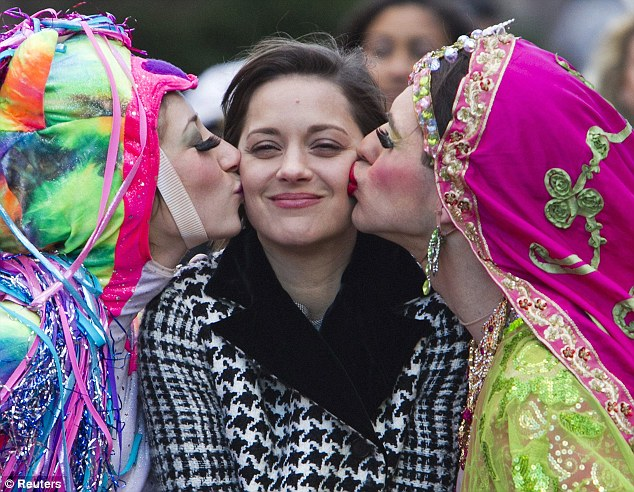 Pucker up! Marion Cotillard was paraded through the streets of Harvard Square as she was named the Hasty Pudding Theatricals Woman of the Year in Cambridge, Massachusetts, last week