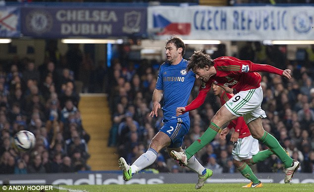 Taking the pressure: Swansea hit Chelsea on the break in the first leg of their Capital One Cup semi final