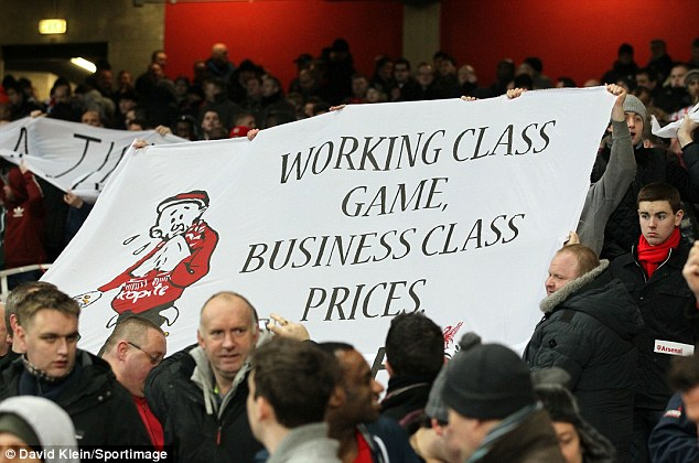 Making their point: Liverpool fans protest at the price of tickets at Arsenal