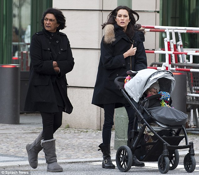 Out and about: Meanwhile, Bruce's wife Emma Heming was seen out with the couple's baby daughter Mabel in Berlin