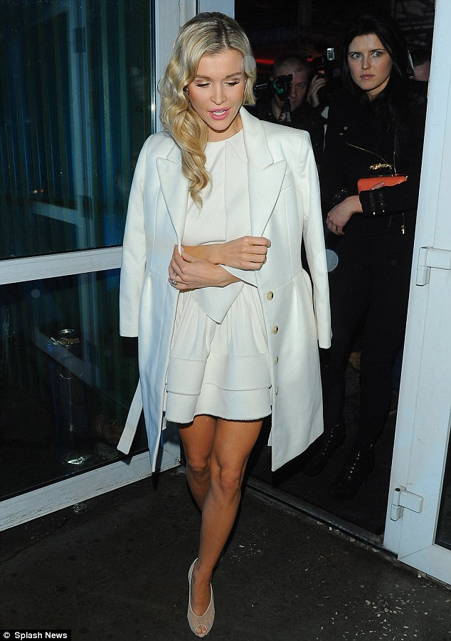 Home time: Following the show, Joanna topped her look with a white mid-length coat