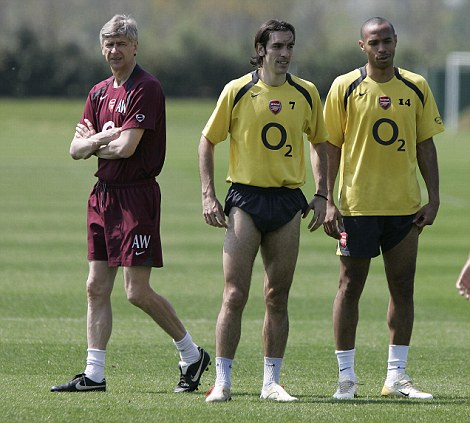 French connection: Robert Pires (centre) and Thierry Henry (right) spearheaded Arsenal's attack