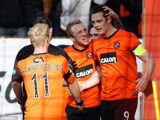 On target: Jon Daly fired the second as the Tangerines eased through