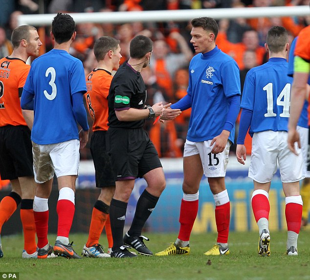 Marching orders: Kai Naismith was shown a straight red late on to compound Rangers' misery