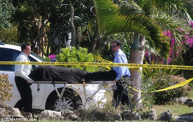 Murder: A body is removed from a house in Boynton Beach, Florida where a father killed his two young sons in the early hours of Saturday