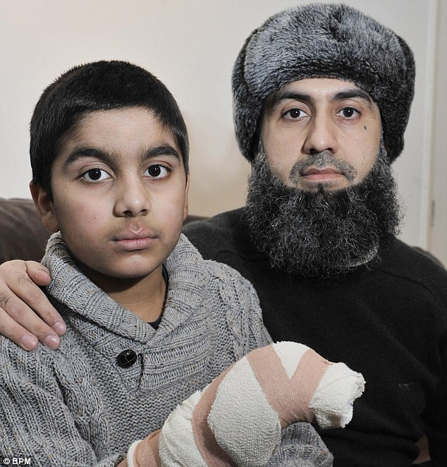 Caring: Abdullah with his father Saqib who has other children at the school where his son had his accident