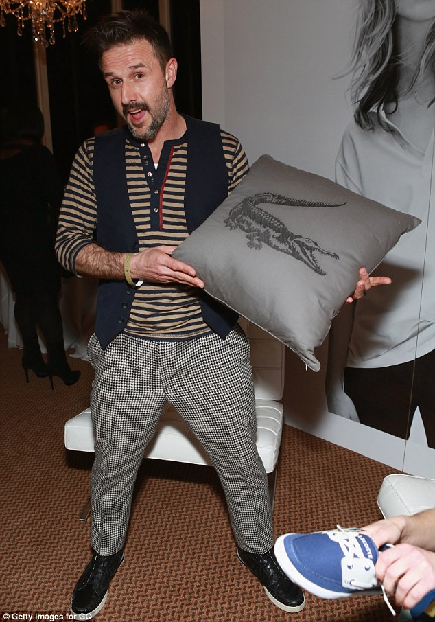 Swag to bag:  David Arquette shows off a Lacoste cushion