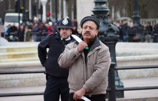 Dramatic: Police officers tasered Talhat Rehman to the ground outside the Palace last year