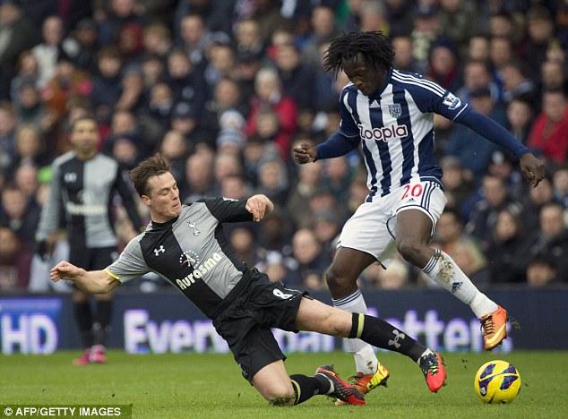 No holds barred: Tottenham's Scott Parker slides in to take the ball of Romelu Lukaku