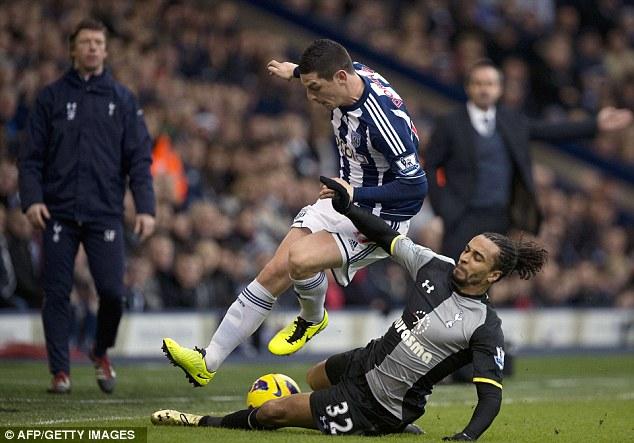 Physical: Tottenham defender Benoit Assou-Ekotto tackles West Brom midfielder Graham Dorrans