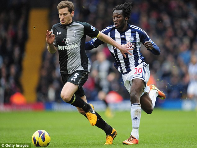 Hot pursuit: Jan Vertonghen is chased by Romelu Lukaku during the match at The Hawthorns