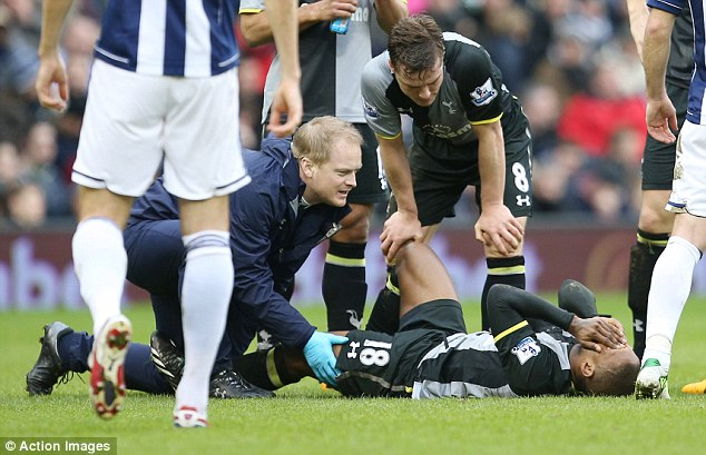Injury blow: Jermain Defoe goes down in pain late in the first half. The Tottenham striker was replaced by new signing Lewis Holtby