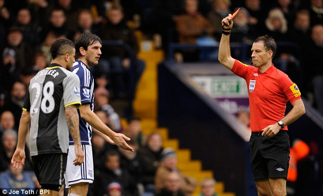 Dismissed: West Brom's Goran Popov is sent off early in the second half for spitting