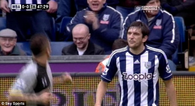 Ugly incident: Goran Popov appeared to spit at Tottenham's Kyle Walker in a confrontation early in the second half, leading to Walker washing his face (below) and Popov being sent off by Mark Clattenburg (bottom)