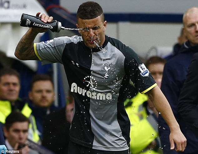 Tottenham Hotspur's Kyle Walker washes his face after West Bromwich Albion's Goran Popov was sent off for spitting