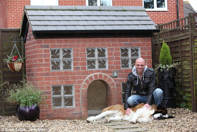 Home sweet home: Julian Kite outside the house he built for Wellington his two-year-old St Bernard