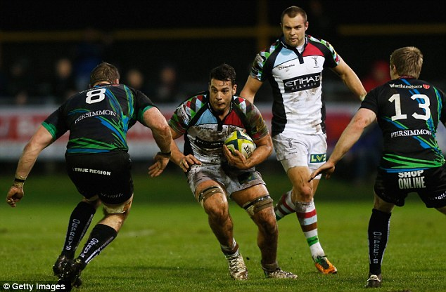 On the attack: Dave Ward of Harlequins charges toward the Ospreys defence