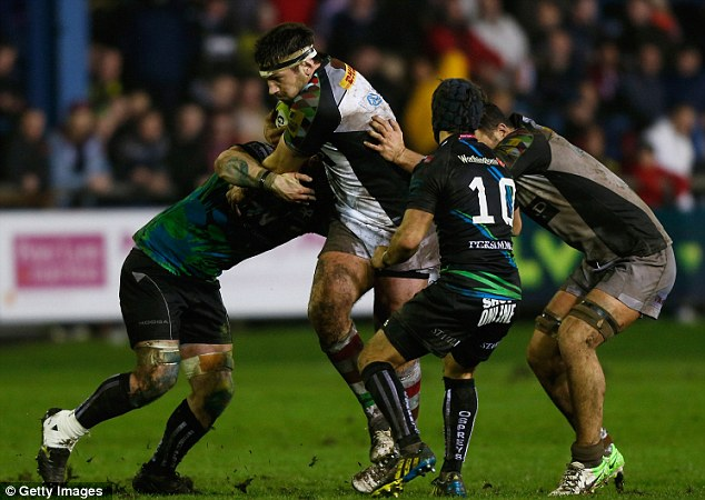 Stopped: Guest  is mobbed by Ospreys players during the tight match