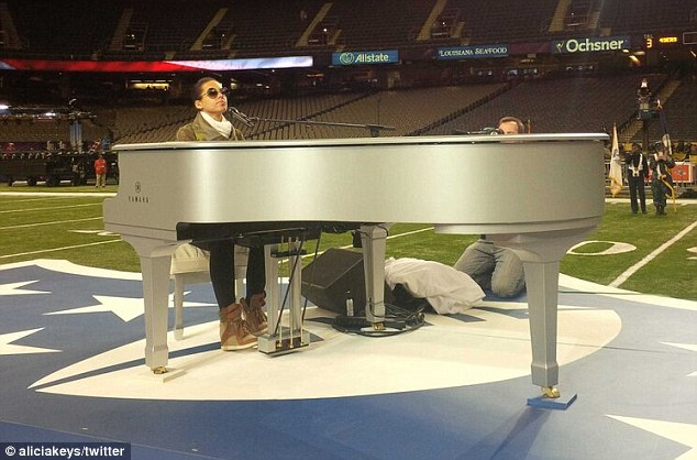 In rehearsal: Earlier in the day, the star posted a snap of her rehearsals, where she is seen sitting at a silver piano in the middle of the football pitch, presumably taken the day before